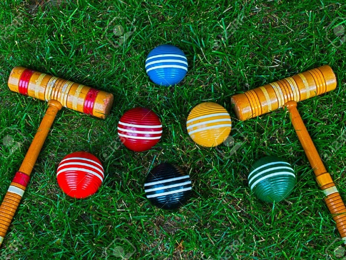 9700528-Croquet-mallets-and-balls-on-grass-background-Stock-Photo-croquet