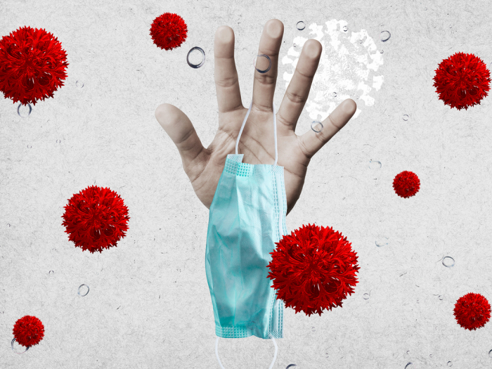 hand_holding_face_mask_surrounded_by_virus_morphology_covid-19_coronavirus_pandemic_by_rawpixel_wan_id_2317454_cc0_2400x1600-100839292-large