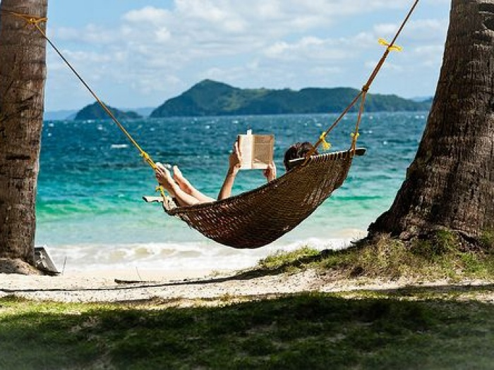 reading in a hammock on the beach
